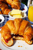 Croissants with jam and butter. Stock Images