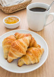 Croissants with jam and coffee cup Royalty Free Stock Image