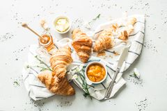 Croissants, jam, honey and butter - continental breakfast stock photo