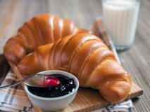 Croissants with jam on a wooden background Stock Photo