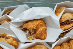Croissants with jamon and cheese served in paper bags closeup Royalty Free Stock Image