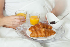 Croissants and juice on breakfast Stock Images