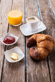 Croissants and juice Stock Images