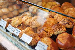 Croissants lying in display in the bakery royalty free stock images