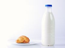 Croissants and milk Stock Images