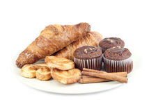 Croissants, muffins, cookies and stiks cinnamon of plate Stock Images