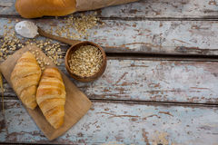 Croissants, oats and spoon with flour Stock Photo