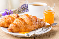 Croissants with orange jam and coffee. French breakfast. Croissants with orange jam and coffee. Shallow depth of field Royalty Free Stock Photo