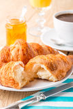 Croissants with orange jam and coffee. Royalty Free Stock Image