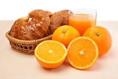 Croissants and orange juice Stock Photos