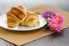 Croissants with orange juice Stock Images