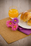 Croissants with orange juice Stock Image