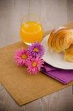 Croissants with orange juice Stock Image