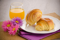 Croissants with orange juice Royalty Free Stock Photography
