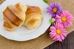 Croissants with orange juice Stock Images