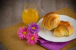 Croissants with orange juice Stock Photos