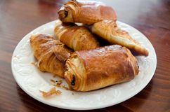 Croissants. And Pain au chocolat on a plate Stock Images