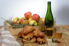 Croissants and pains au chocolat with apples Stock Image