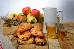 Croissants and pains au chocolat with a box of apples Royalty Free Stock Image