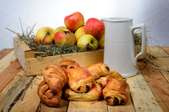 Croissants and pains au chocolat with a box of apples Royalty Free Stock Photography