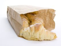 Croissants in paper bag Stock Photos