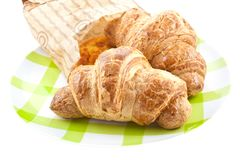 Croissants in paper pack on plate isolated Royalty Free Stock Photos