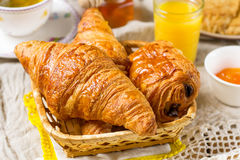 Croissants pastry for breakfast with tea and orange juice royalty free stock photography