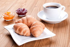Croissants in a plate on the table Royalty Free Stock Images