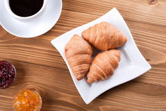 Croissants in a plate on the table Royalty Free Stock Photography