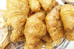 Croissants with poppy and sesame in a basket Stock Photo
