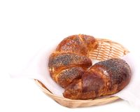 Croissants with poppy on wicker basket. Royalty Free Stock Photo