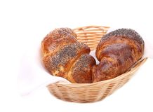 Croissants with poppy on wicker basket. Stock Images