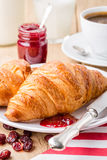 Croissants with raspberry jam and coffee. Royalty Free Stock Photo
