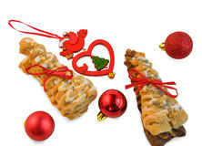 Croissants with red ribbon and Christmas decorations on white. Royalty Free Stock Image