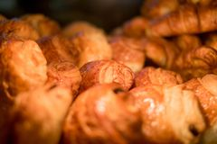 Croissants in the showcase at the bakery royalty free stock photography