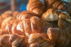 Croissants in the showcase at the bakery stock images