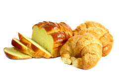 Croissants and sliced bread. On white background Royalty Free Stock Photography