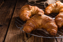 Croissants. Some fresh baked Croissants on vintage wooden background Stock Images