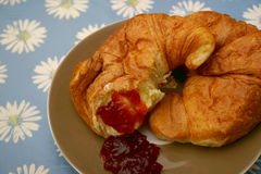 Croissants. Some croissants with a jam of strawberries and sugar Stock Image