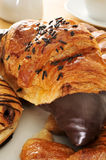 Croissants. Some croissants on a plate, on a set table for breakfast stock photography
