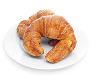 Croissants. Some croissants on a plate, on a white background Stock Image