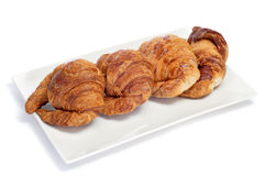 Croissants. Some croissants on a plate, on a white background royalty free stock images