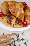 Croissants, spice, berries, in a plate Royalty Free Stock Photo