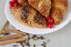 Croissants, spice, berries, in a plate Royalty Free Stock Photos