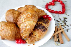 Croissants, spice, berries, in a plate and heart Royalty Free Stock Photos