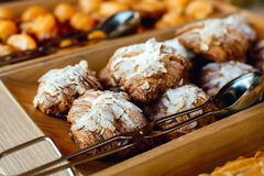 Croissants sprinkled with almonds, powdered suga Stock Images