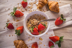 Croissants and strawberries Stock Photo