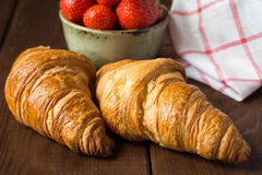 Croissants and strawberries Royalty Free Stock Photo