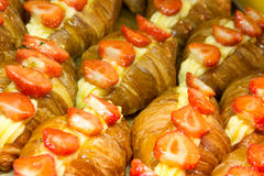 Croissants with strawberries Stock Images