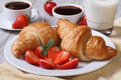 Croissants with strawberry, coffee and milk - healthy breakfast Royalty Free Stock Photo